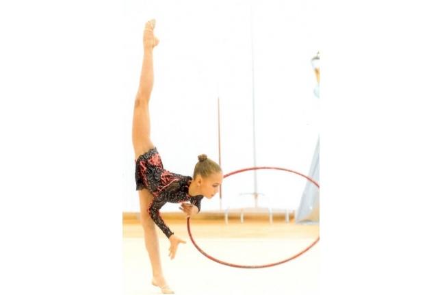 Маша на занятиях гимнастикой